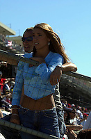 Babe and boyfriend watch the race