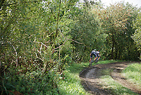 the 2 race leaders almost crash out of a muddy corner as they can't control their brakes over the (very) slippery 'gravel' roads<br /> <br /> 90th Schaal Sels 2015