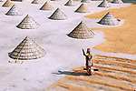 Mounds of rice at mill by Sabina Akter