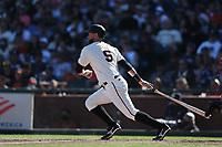 SAN FRANCISCO, CA - SEPTEMBER 19:  Brandon Belt #9 of the San Francisco Giants bats against the Atlanta Braves during the game at Oracle Park on Sunday, September 19, 2021 in San Francisco, California. (Photo by Brad Mangin)