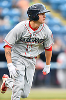 Lakewood BlueClaws center fielder Mickey Moniak (22) runs to first base during a game against the Beer City Tourists at McCormick Field on June 1, 2017 in Asheville, North Carolina. The Tourists defeated the BlueClaws 8-5. (Tony Farlow/Four Seam Images)