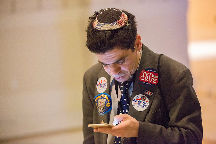 A supporter with political buttons and pins atrends the 2015 Conservative Political Action Conference (CPAC) outside Washington, DC