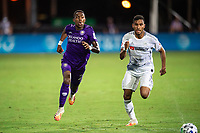 LAKE BUENA VISTA, FL - JULY 31: Andres Perea #21 of Orlando City SC battles for the ball during a game between Orlando City SC and Los Angeles FC at ESPN Wide World of Sports on July 31, 2020 in Lake Buena Vista, Florida.