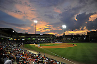 The sun sets on the final home game of the year between the Rome Braves and Greenville Drive on Thursday, September 1, 2016 at Fluor Field at the West End in Greenville, South Carolina. (Tom Priddy/Four Seam Images)