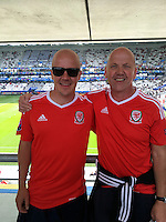 COPY BY TOM BEDFORD MEDIA<br /> Pictured: Matt Evans (L) with his dad Chris in France to watch Wales play against Slovakia<br /> Re: Former postman, lotto Millionaire Matt Evans, 35, from Barry, south Wales, has been spending his winnings to watch Wales play in the UEFA European Championship in France.