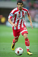 MELBOURNE, AUSTRALIA - DECEMBER 11: Aziz Behich of the Heart controls the ball during the round 18 A-League match between the Melbourne Heart and Melbourne Victory at AAMI Park on December 11, 2010 in Melbourne, Australia. (Photo by Sydney Low / Asterisk Images)