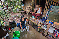 Pa Pa, Laundress, Yangon, Myanmar, 2016<br /> Pa Pa Phyo Swe works doing laundry by hand for a local university in Yangon. Kyaw Kyaw watches as his wife washes. He likes her working and the extra income it brings in. He works as an electrician, and together they make about $200 a month. Pa Pa was able to procure a small loan and would like to buy a washing machine with it.