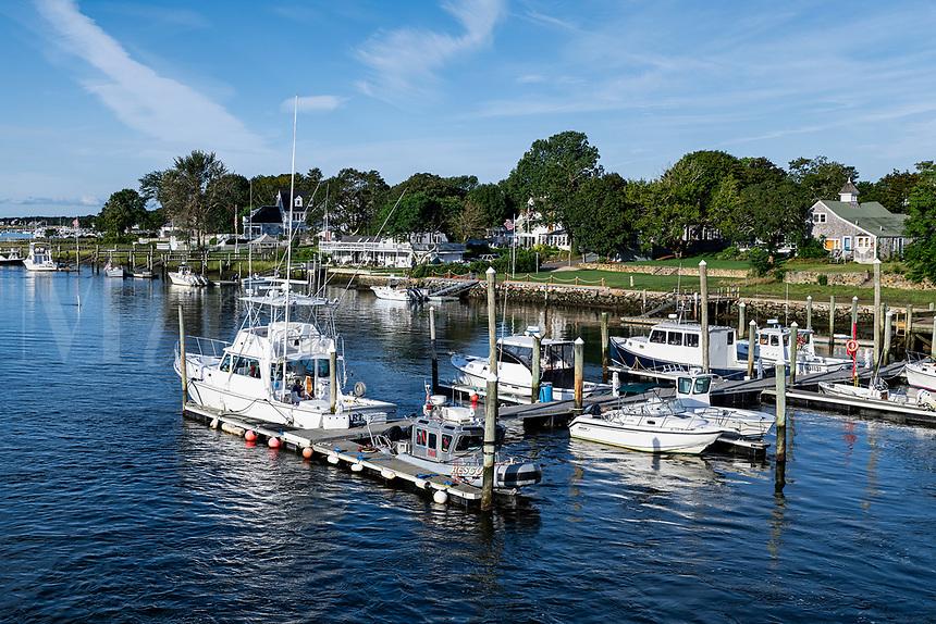 Boats docked along Bass River, South Yarmouth, Cape Cod, Massachusetts, USA.