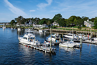 Boats docked along Bass River, South Yarmouth, Cape Cod, Massachusetts, USA.