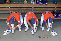 Richie Shaffer (8), Brad Miller (13) and Kevin Caughman (37) of the Clemson Tigers change into their game spikes in the dugout prior to a game against the Michigan State Spartans on Sunday, Feb. 27, 2011, at Fluor Field in Greenville, S.C. Photo by Tom Priddy/Four Seam Images