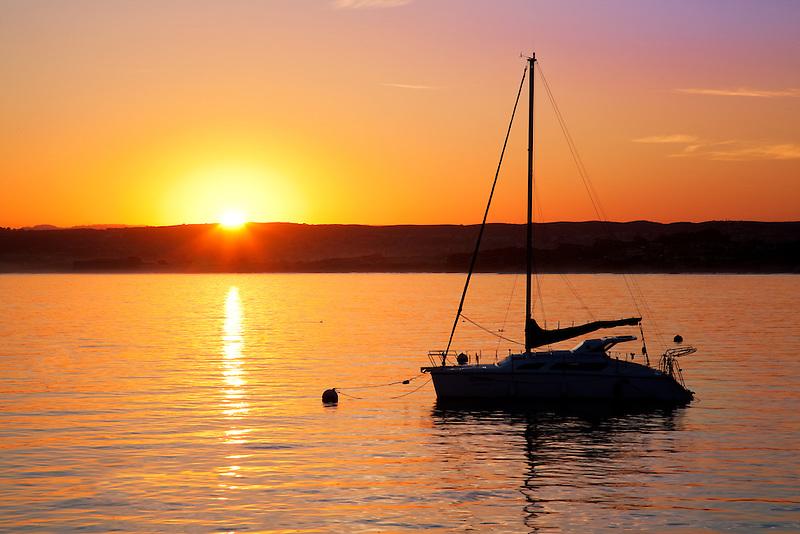 Sunrise and sailboat. Monterey Bay, Caliifornia