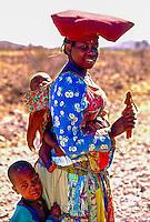 Herero mom with her children hanging pupin