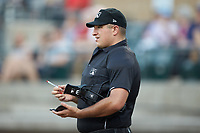 Home plate umpire Thomas O'Neil makes changes to the lineup card during the Appalachian League game between the Greeneville Reds and the Pulaski Yankees at Calfee Park on June 23, 2018 in Pulaski, Virginia. The Reds defeated the Yankees 6-5.  (Brian Westerholt/Four Seam Images)