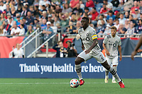 FOXBOROUGH, MA - JULY 25: Victor Wanyama #2 of CF Montreal dribbles at midfield during a game between CF Montreal and New England Revolution at Gillette Stadium on July 25, 2021 in Foxborough, Massachusetts.