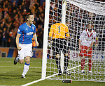 Jon Daly celebrates his debut competitive goal for Rangers
