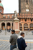 Two teenage boys in a street in Bologna