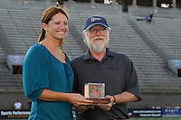 Danielle Fotopoulos a member of the 1999 FIFA World Cup winning team is presented with an award honoring the achievement by Jack Huckel, Director of Museum and Archives at the National Soccer Hall of Fame during a ceremony at half time. Sky Blue FC defeated the Boston Breakers 2-1 during a WPS regular season match at Harvard Stadium in Boston, MA, on July 12, 2009.