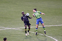 COLUMBUS, OH - DECEMBER 12: Gyasi Zardes #11 of the Columbus Crew and Gustav Svensson #4 of the Seattle Sounders FC challenge for the ball during a game between Seattle Sounders FC and Columbus Crew at MAPFRE Stadium on December 12, 2020 in Columbus, Ohio.