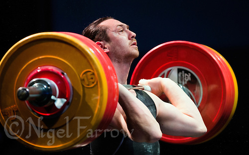 10 MAY 2014 - COVENTRY, GBR - Mehmed Fikretov from the Crystal Palace Weightlifting Club attempts to complete a lift during the men's 77kg A category round at the British 2014 Senior Weightlifting Championships and final 2014 Commonwealth Games qualifying event round at the Ricoh Arena in Coventry, Great Britain (PHOTO COPYRIGHT © 2014 NIGEL FARROW, ALL RIGHTS RESERVED)