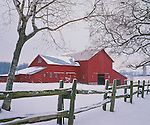 LaSalle County, IL<br /> A dusting of snow on a split rail fence that borders the entrance to a large red barn