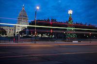 Capitol Christmas Tree in Austin, Texas as car light trails streak by.