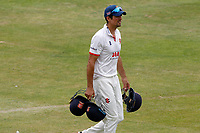 Sir Alastair Cook of Essex walks off with handfuls of helmets during the lunch interval during Essex CCC vs Kent CCC, Bob Willis Trophy Cricket at The Cloudfm County Ground on 1st August 2020
