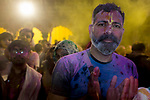 A devottee of Lord Krishna prays during Holi Festival at Vrindavan. Holi - The  Hindu festival of colour is celibrated for a week in the Brraj region of Uttar Pradesh, India.