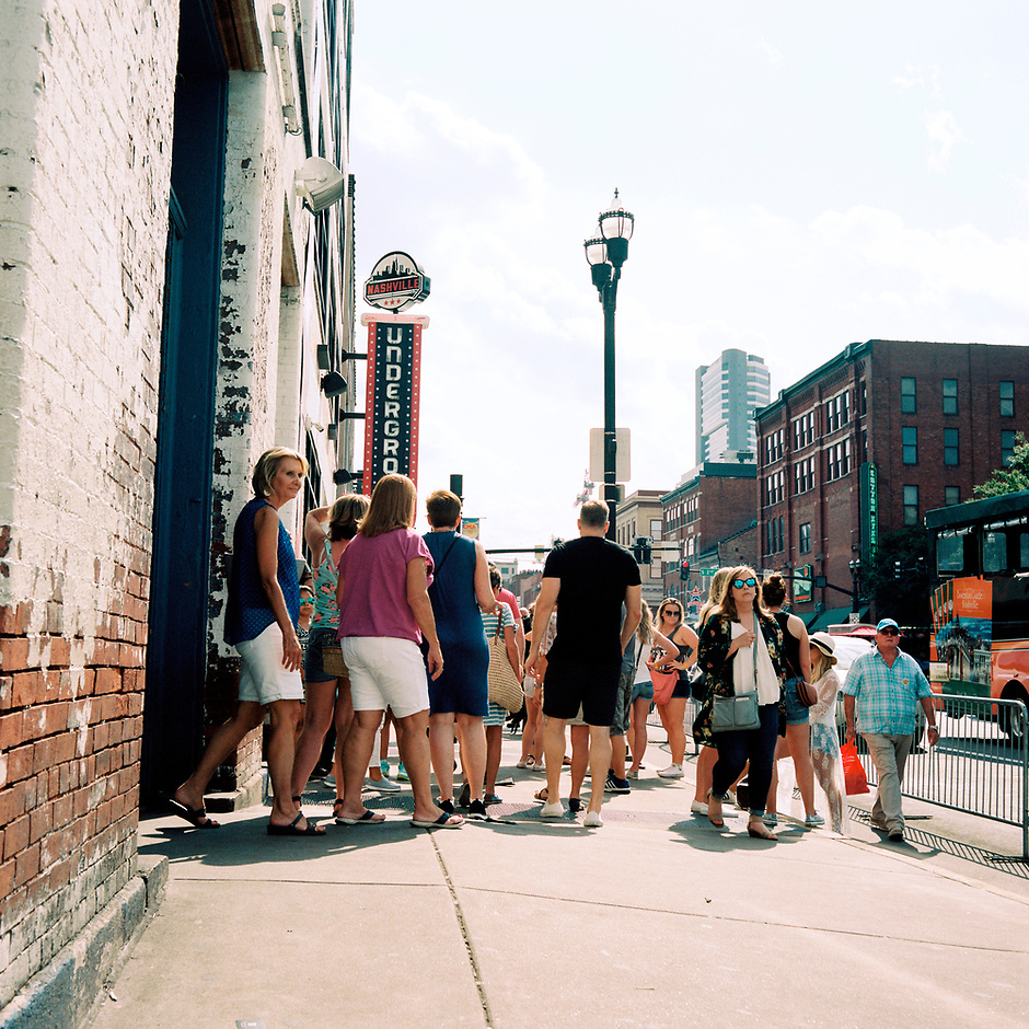 Patrons flow in and out of a honky tonk bar along Lower Broadway in Nashville, Tennessee on Saturday, May 19, 2018. (Photo by James Brosher)