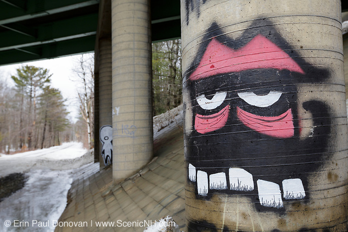 Graffiti on bridge overpass along the old Pemigewasset Valley Railroad in Plymouth, New Hampshire. The Pemigewasset Valley Railroad connected Plymouth to North Woodstock. Today, this section of railroad is operated by the Hobo and Winnipesaukee Scenic Railroads.