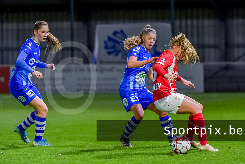Gent's defender Fran Meersman (5) , Gent's defender Lindsey Van Belle (14) and Standard forward Davinia Vanmechelen (25) pictured during a female soccer game between  AA Gent Ladies and Standard Femina de Liege on the 8 th matchday of the 2020 - 2021 season of Belgian Scooore Womens Super League , friday 20 th of November 2020  in Oostakker , Belgium . PHOTO SPORTPIX.BE | SPP | STIJN AUDOOREN
