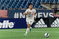 FOXBOROUGH, MA - JULY 23: Nicolas Ovalle #51 of Toronto FC II passes the ball during a game between Toronto FC II and New England Revolution II at Gillette Stadium on July 23, 2021 in Foxborough, Massachusetts.
