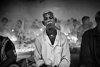 """During Kartik, """"the holiest month"""" beginning every year with the new moon in November, thousands of Hindu devotees celebrate the feast of Rakher Upobash, fasting and praying the gods sitting before the Shri Shri Lokanath Brahmachari Ashram, among the Swami Bagh Temple near Dhaka, Bangladesh. The worshippers offer candles called Prodip, meditate, give to charity, and generally perform austerity. <br /> The faithful pray while thick clouds of incense raise into the air.<br />  Barodi, Dhaka, Bangladesh. Nov. 11, 2014"""
