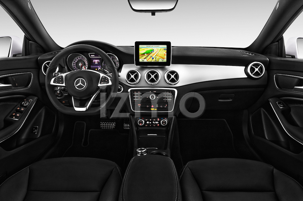 Stock photo of straight dashboard view of a 2015 Mercedes Benz CLA Class 220 AMG line 5 Door Wagon