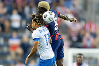 KANSAS CITY, KS - JULY 11: Gyasi Zardes #9 of the United States wins the header during a game between Haiti and USMNT at Children's Mercy Park on July 11, 2021 in Kansas City, Kansas.