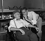 Pittsburgh PA:  Brady Stewart Sr and Dave VanDeVeer discussing important things in the office at 725 Liberty Avenue. Brady Stewart founded the business in 1912 and Dave VanDeVeer was both an excellent studio and on location photographer for Brady Stewart Studio.