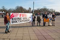"""Menschenrechtsaktion der Gesellschaft fuer bedrohte Voelker (GfbV) vor dem Laenderspiel Deutschland-Brasilien. Unter dem Motto """"FIFA: Keine Spiele fuer Diktatoren –Menschenrechte staerker beruecksichtigen!"""" protestierte die GfbV am Dienstag den 27. Maerz 2018 vor dem Berliner Olympiastadion gegen die Vergabe von Weltmeisterschaften an Diktaturen wie Russland oder Katar. Die Organisation fordert """"dass bei der Vergabe der Turniere Menschenrechte zukuenftig eine groessere Rolle spielen muessen. Wer Meinungs- und Pressefreiheit mit Fuessen tritt, willkuerlich verhaften und foltern laesst und beim Bau von Stadien massiv Menschenrechte verletzt, disqualifiziert sich selbst als Austragungsort fuer WM-Turniere.""""<br /> Im Bild:<br /> 27.1.2018, Berlin<br /> Copyright: Christian-Ditsch.de<br /> [Inhaltsveraendernde Manipulation des Fotos nur nach ausdruecklicher Genehmigung des Fotografen. Vereinbarungen ueber Abtretung von Persoenlichkeitsrechten/Model Release der abgebildeten Person/Personen liegen nicht vor. NO MODEL RELEASE! Nur fuer Redaktionelle Zwecke. Don't publish without copyright Christian-Ditsch.de, Veroeffentlichung nur mit Fotografennennung, sowie gegen Honorar, MwSt. und Beleg. Konto: I N G - D i B a, IBAN DE58500105175400192269, BIC INGDDEFFXXX, Kontakt: post@christian-ditsch.de<br /> Bei der Bearbeitung der Dateiinformationen darf die Urheberkennzeichnung in den EXIF- und  IPTC-Daten nicht entfernt werden, diese sind in digitalen Medien nach §95c UrhG rechtlich geschuetzt. Der Urhebervermerk wird gemaess §13 UrhG verlangt.]"""