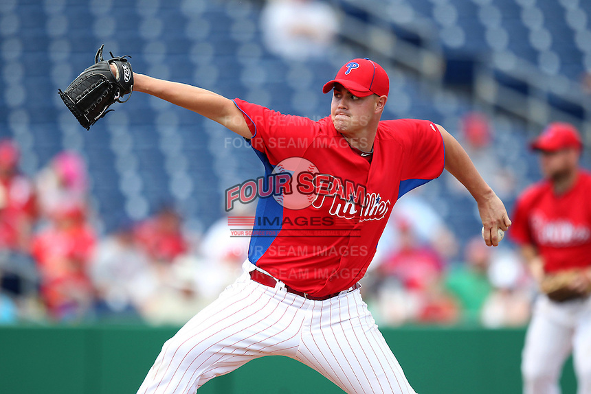 Philadelphia Phillies pitcher Jeremy Horst #65 delivers a pitch during a scrimmage against the Florida State Seminoles at Brighthouse Field on February 29, 2012 in Clearwater, Florida.  Philadelphia defeated Florida State 6-1.  (Mike Janes/Four Seam Images)