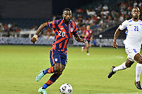 KANSAS CITY, KS - JULY 15: Shaq Moore #20 of the United States with the ball during a game between Martinique and USMNT at Children's Mercy Park on July 15, 2021 in Kansas City, Kansas.