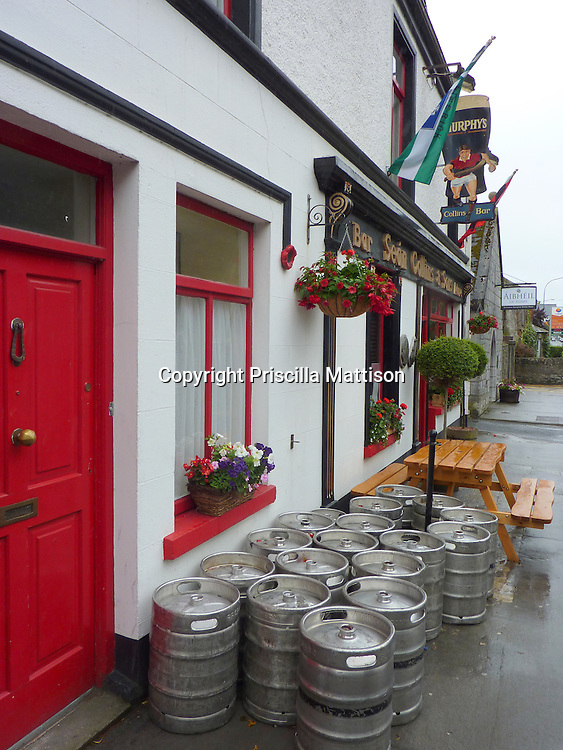 Adare, Republic of Ireland - July 18, 2010:  Numerous beer kegs stand in front of a pub.