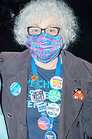 """A delegate wore campaign buttons including """"United with Biden,"""" """"No Malarkey,"""" and """"Black Lives Matter"""" as people gathered to watch the 2020 Democratic National Convention at a """"Ridin' with Biden"""" Drive-In Theater viewing event at Suffolk Downs in Boston, Massachusetts, on Wed., Aug. 19, 2020."""
