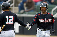 Juan Silverio #18 (right) of the Kannapolis Intimidators is congratulated by Miguel Gonzalez #12 after scoring a run against the Lexington Legends at Fieldcrest Cannon Stadium April 14, 2010, in Kannapolis, North Carolina.  Photo by Brian Westerholt / Four Seam Images