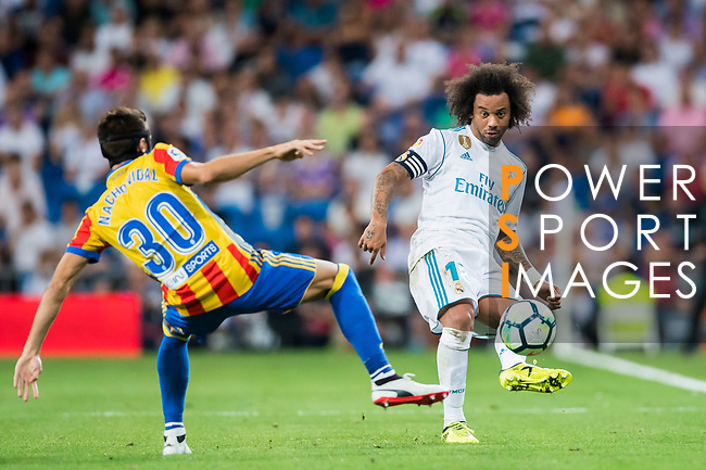 Marcelo Vieira Da Silva (r) of Real Madrid fights for the ball with Nacho Vidal of Valencia CF during their La Liga 2017-18 match between Real Madrid and Valencia CF at the Estadio Santiago Bernabeu on 27 August 2017 in Madrid, Spain. Photo by Diego Gonzalez / Power Sport Images