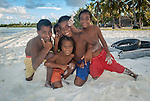 i-Kiribati children posing for the camera in a village on the island of Kiritimati in Kiribati
