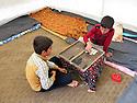 Iraq 2015 <br /> In the camp of Berseve, 2 boys playing board game in a tent  <br /> Irak 2015 <br /> Au camp de Berseve, 2 garcons jouant sous la tente a un jeu de société