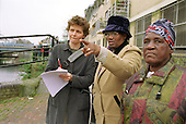 Local residents survey the Grand Union Canal near Ladbroke Grove as part of a Splash environmental improvement programme; 21/3/03.