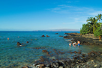 Tourists enjoy snorkeling in the shallow coral beds at Ahihi Bay on the Makena coast of West Maui.