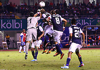 SAN JOSE, COSTA RICA - September 06, 2013: Eddie Johnson (18) of the USA MNT has the ball punched off his head by Keylor Navas (1) of the Costa Rica MNT during a 2014 World Cup qualifying match at the National Stadium in San Jose on September 6. USA lost 3-1.