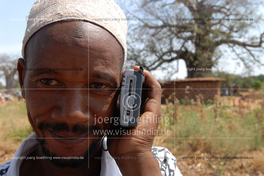 TANZANIA Meatu, man listen radio / TANSANIA Meatu, Mann mit Radio