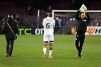Thursday 27 February 2014<br /> Pictured: A disappointed Swansea captain Ashley WIlliams (C) holds his head in his hands as he walks off the pitch with goalkeeping coach Adrian Tucker (R) after his team conceded a third goal<br /> Re: UEFA Europa League, SSC Napoli v Swansea City FC at Stadio San Paolo, Naples, Italy.