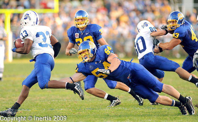 BROOKINGS, SD - SEPTEMBER 19:  SDSU defender Danny Batten #54 dives to make a play on Antoine Brown #33 of Indiana State. (Photo by Craig Johnson/Inertia)